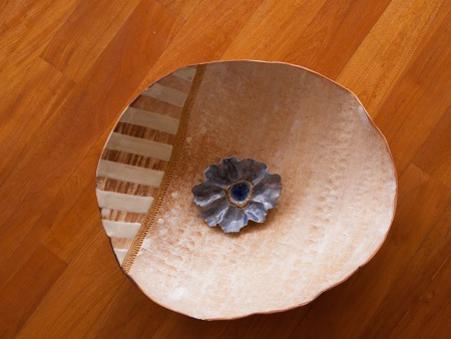 Photographer:web  artforland.auroville.org | Flower in the Bowl by Priya Sundaravali