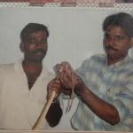 Dr. Kumar traeting a snake from the bio-region