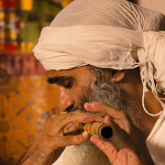 Chandreshi playing flute
