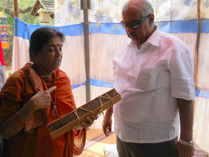 Photographer:Gino | Meenakshi showing a manuscript made with palm leaves