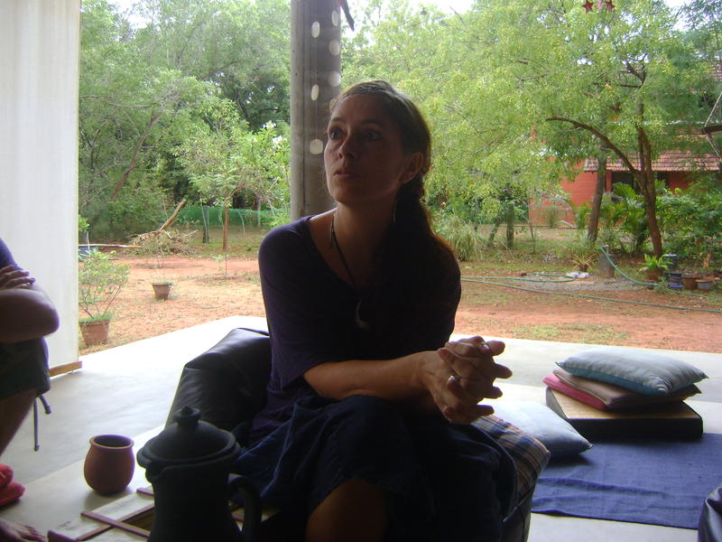 Photographer:Yona   Claire sitting outside in her house and telling us about their project