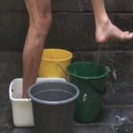 showering with buckets