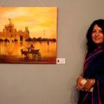 Madhabi Sarkar next to her painting