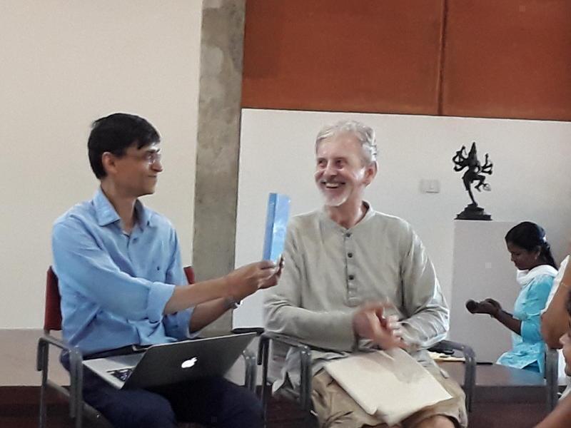 Photographer:Zarin | Makarand R. Paranjape holding new Anu's book on Auroville