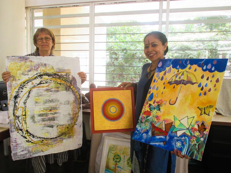 Photographer:Sitharth | Jaya and Devasmita holiding few donated art pieces