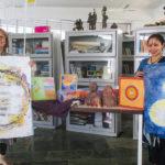 Jaya and Devasmita holiding few donated art pieces