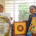 Art for Land - Jaya and Devasmita holding few art pieces
