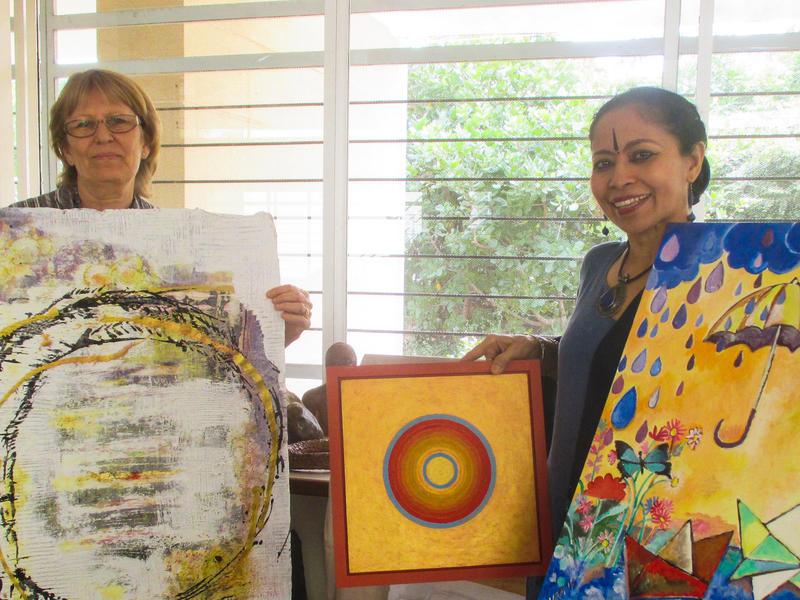 Photographer:web   Art for Land - Jaya and Devasmita holding few art pieces