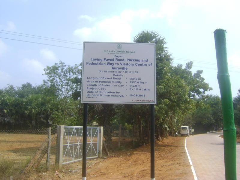 Photographer:Antonio | The board placed shows the information of the new paved roads in  Auroville.