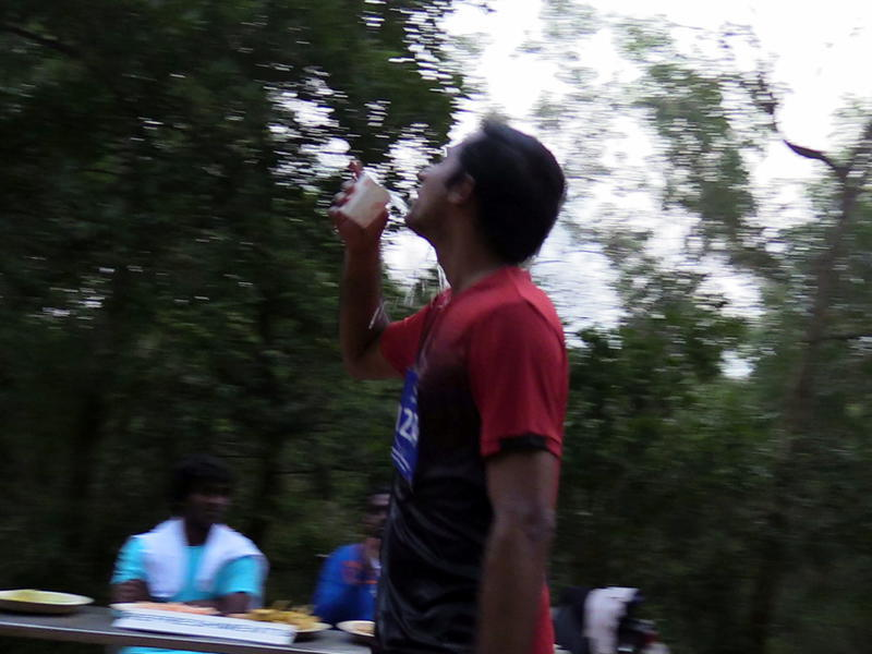 Photographer:Andrea | A 42Km runner pouring water in his mouth