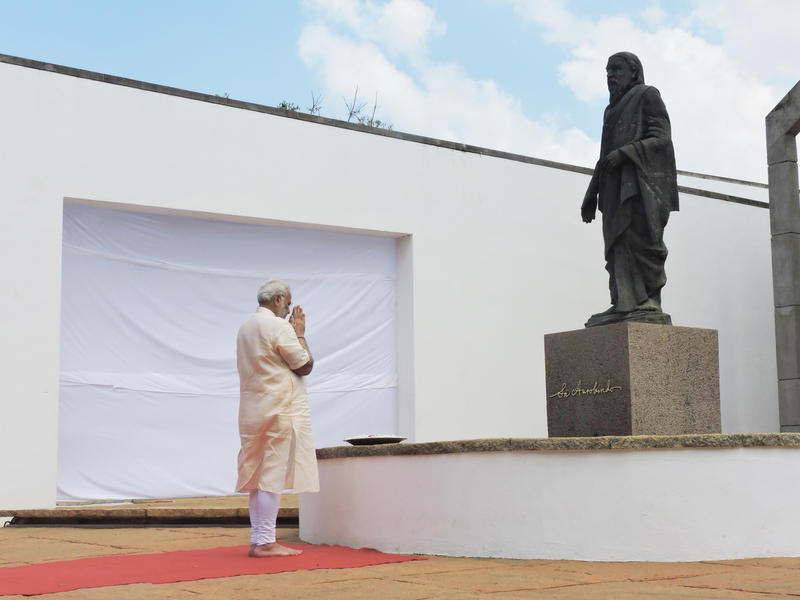 Photographer:Romel | Prime Minister Narendra Modi paying tributes to Sri Aurobindo at Savatri Bhavan, Auroville.