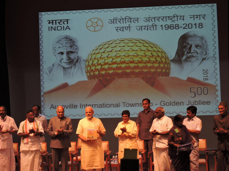 Photographer:Romel | Prime Minister releasing a commemorative postage stamp on the occasion of Auroville's 50th Anniversary.