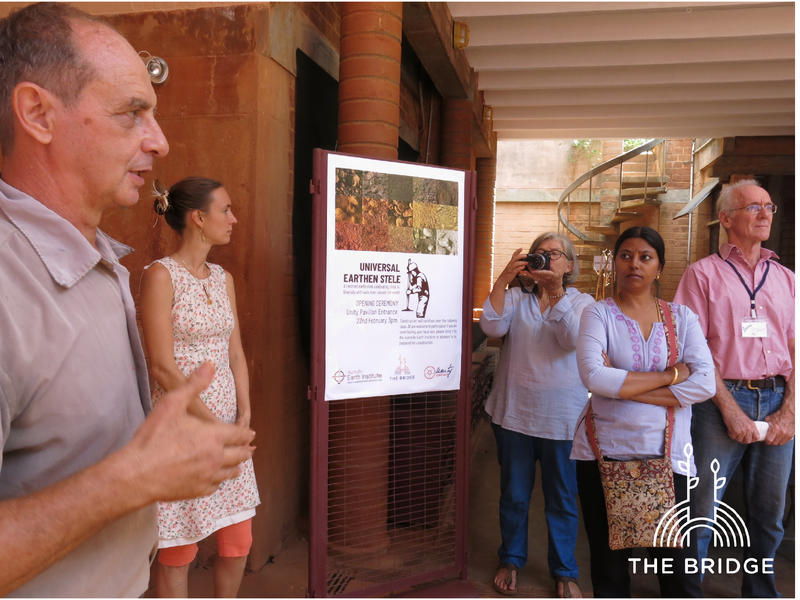 Photographer:Cassandra   Satprem Maini showing us around the Auroville Earth Institute