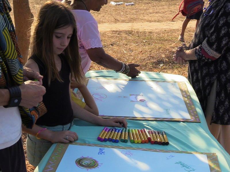 Photographer:S. Praneeth Simon   Girl looks at the unity flag board.