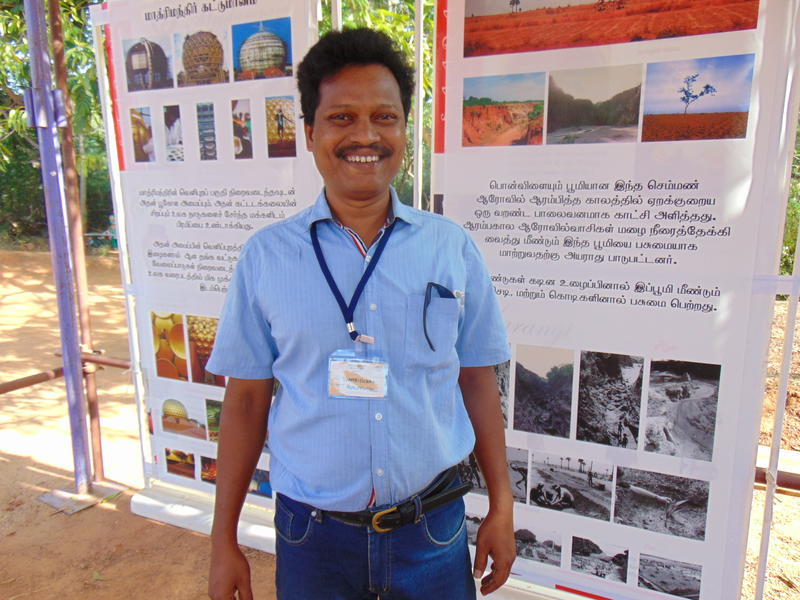 Photographer:Alma | Thamibidurai from Auroville Archives explains exhibition