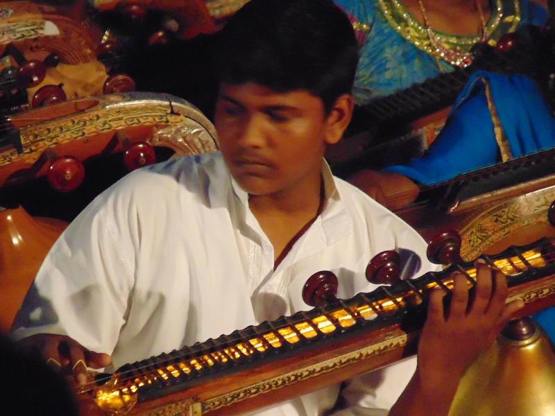 Photographer:Vida | Rishi playing veena