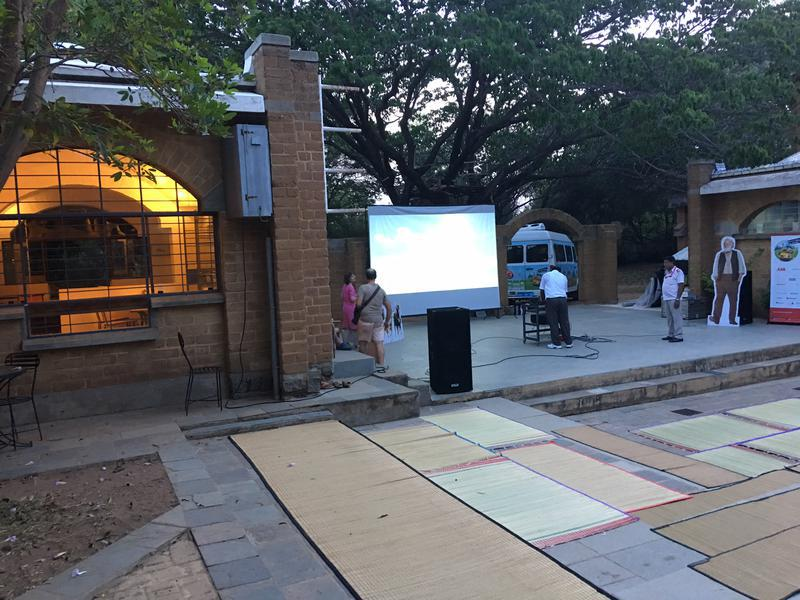 Photographer:David Tomkins   Setting up the video and sound system for the screening of the movie