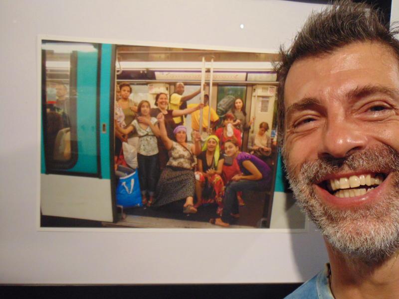 Photographer:Gino | Photographer Eric Chacra next to one of his photos