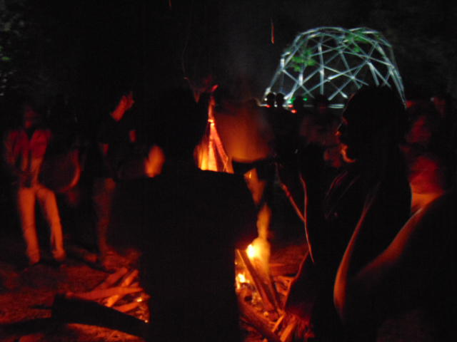 Photographer:Gabriel | Tribe around fire, dome in background