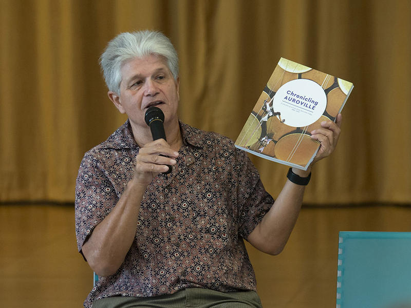 Photographer:Marco Saroldi | Mr Carel holding up the Auroville today 12 year compilation 2006 - 20018