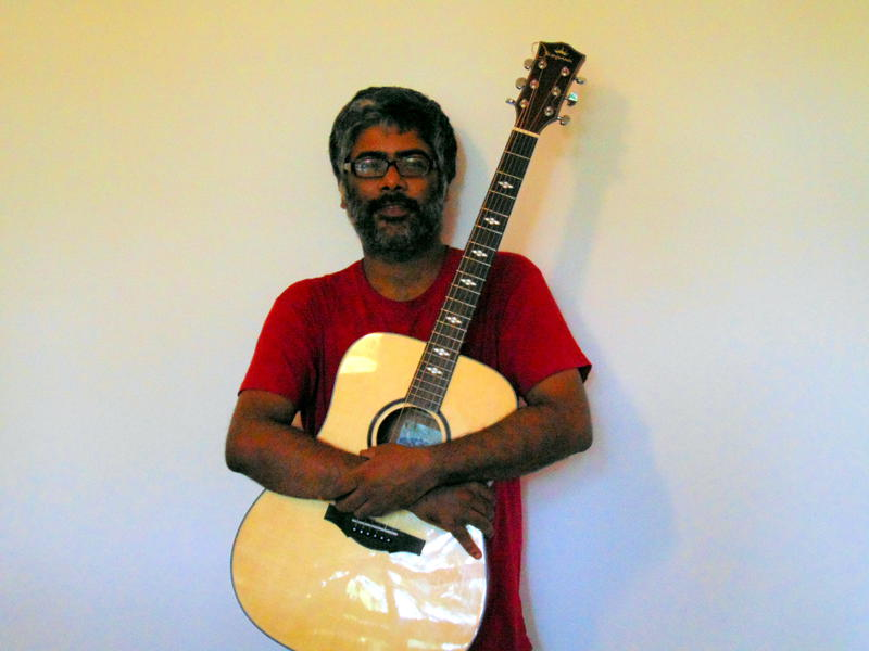 Photographer:Zarin   Ananth Menon with his guitar
